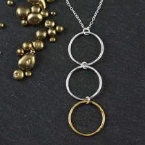 Three Small Hammered Ring Necklace