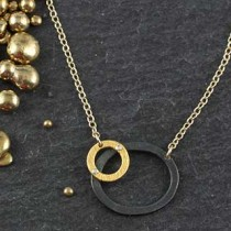 Riveted Geometric Oval Necklace